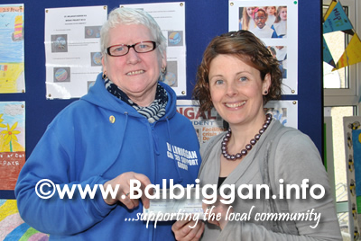 Cora Neilis from Balbriggan Cancer Support Group receiving the cheque from Teacher Gillian O'Brien from St. Molagas NS
