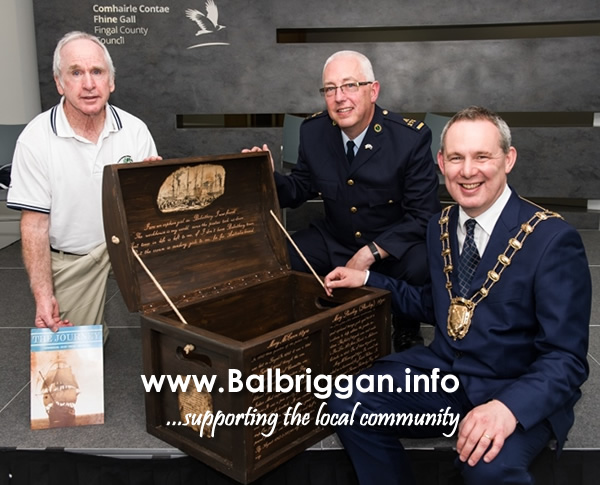 Mayor of Fingal Cllr Darragh Butler receives a Famine Travel Box on behalf of Fingal County Council from Michael Blanch, Chief Executive of the Committee for the Commemoration of Irish Famine Victims and Mark O'Brien, Assistant Chief Officer, Irish Prison Service.
