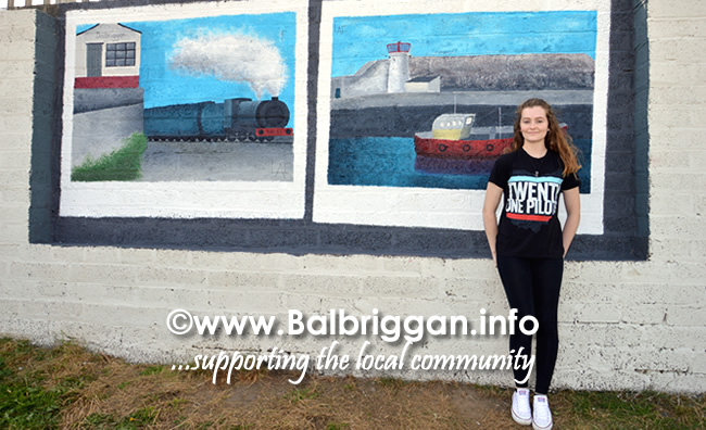 Lauryn Flynn , artist from Balbriggan with her work at the beach walkway