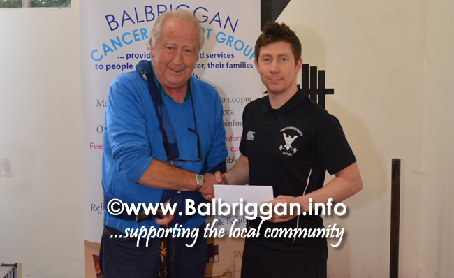 Tom Quinlan from Balbriggan Cancer Support Group being presented with the cheque by John Cullen