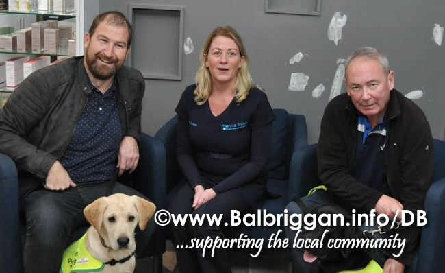 Rhona Tolan  with Rhona and Rubble puppies in training and puppy walkers Barry Kelly and Ronan Daly