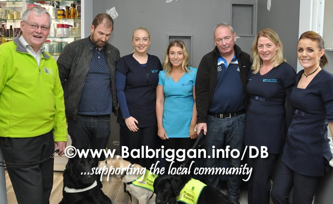 Tom O'Neill with Gatsby the guide dog, Barry Kelly with Rhona blonde puppy in training, Ronan Daly with Rubble puppy in training