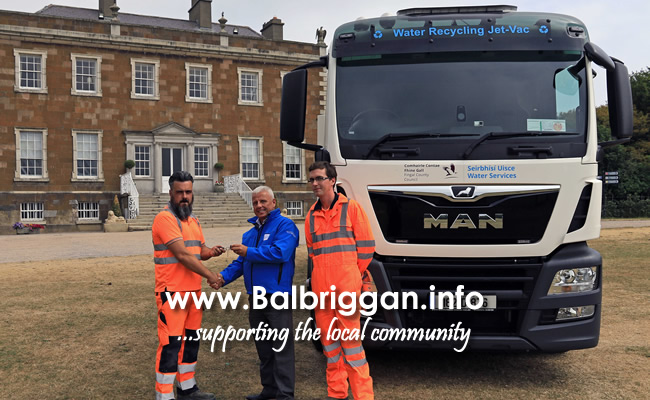 William Garbutt.Ervia handing keys toDavid McGee and John Long who were appointed in their new job role as driver operators of the recycler truck here at Fingal County Council.