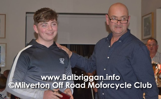 Benn O'Brien receiving his award for youth rider of the year from Edward Russell