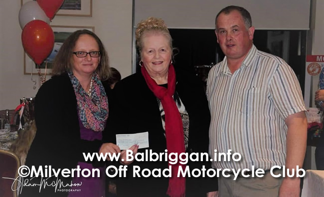 Niamh and Mrs. Grimes receiving donation from Andrew Plant2