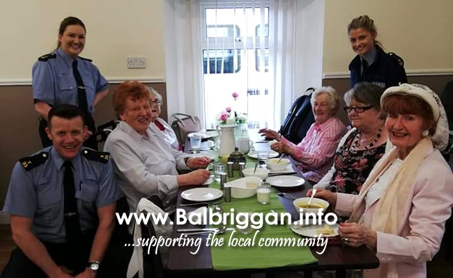Local Gardai visiting Balbriggan Meals on Wheels Dinner Club
