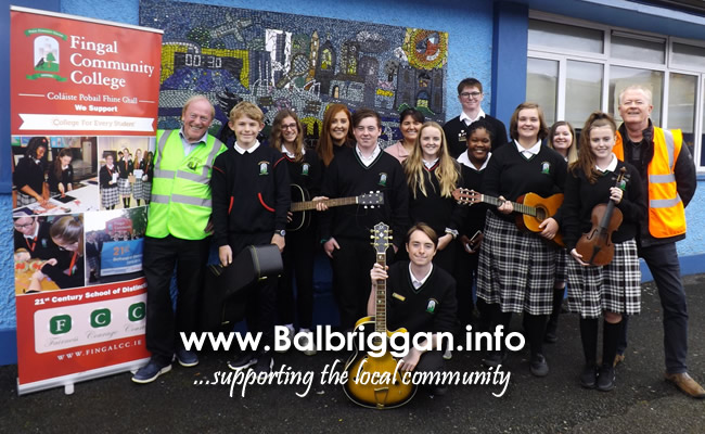Environmental Awareness Officer, Sinead Fox along with members of Swords Tidy Towns presenting instruments to students from Fingal Community College